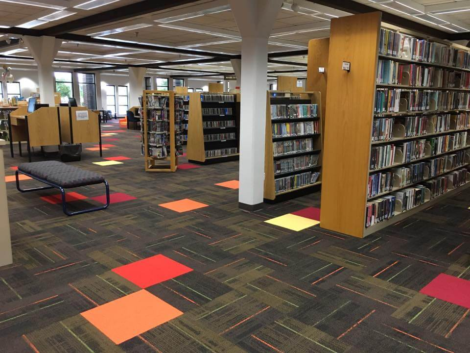 An interior shot of the library, showing off the new carpet, which is predominantly dark brown with color highlights in orange, green, yellow, and red
